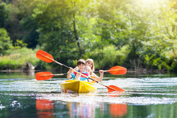child on kayak. kids on canoe. summer camping. - kayaking stock pictures, royalty-free photos & images
