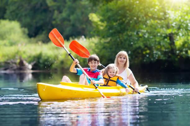 Child on kayak. Kids on canoe. Summer camping. stock photo