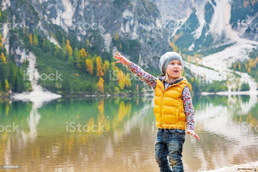 Child  on lake braies in south tyrol, italy stock photo