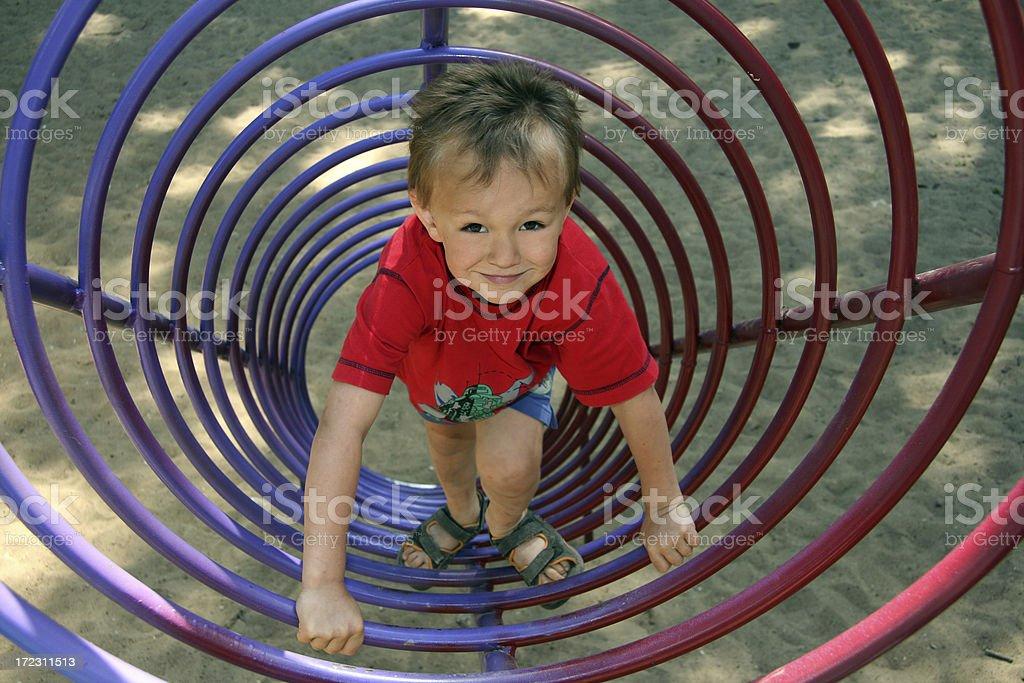 child on  round ladder stock photo