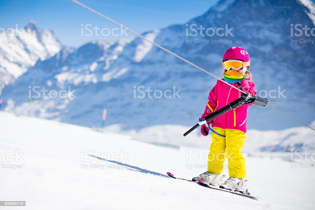 Child on ski lift stock photo