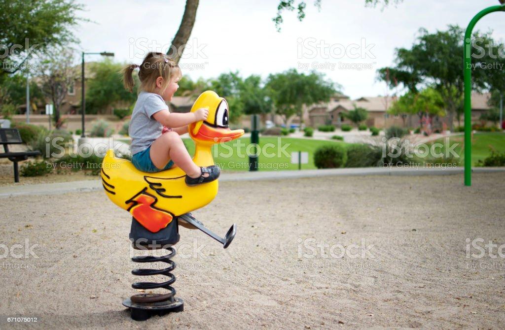 Child on spring rider stock photo
