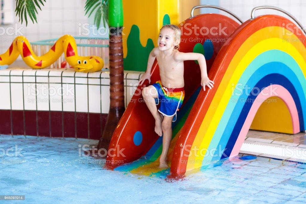 Child On Swimming Pool Slide Kids Swim Water Fun Royalty Free Stock Photo