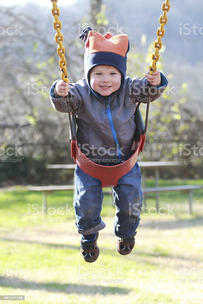 Child on Swing at a Playground stock photo