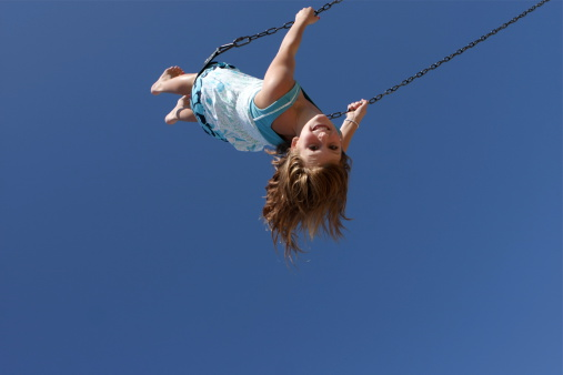 Child On Swing Stock Photo - Download Image Now