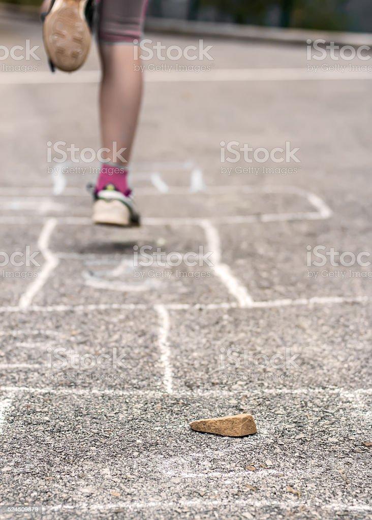 Child on the hopscotch stock photo
