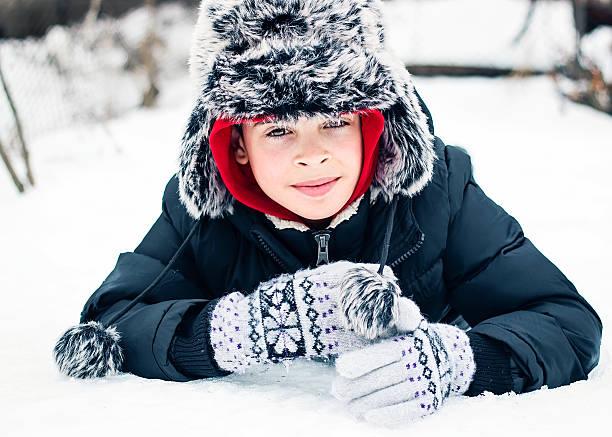 Child on the snow stock photo