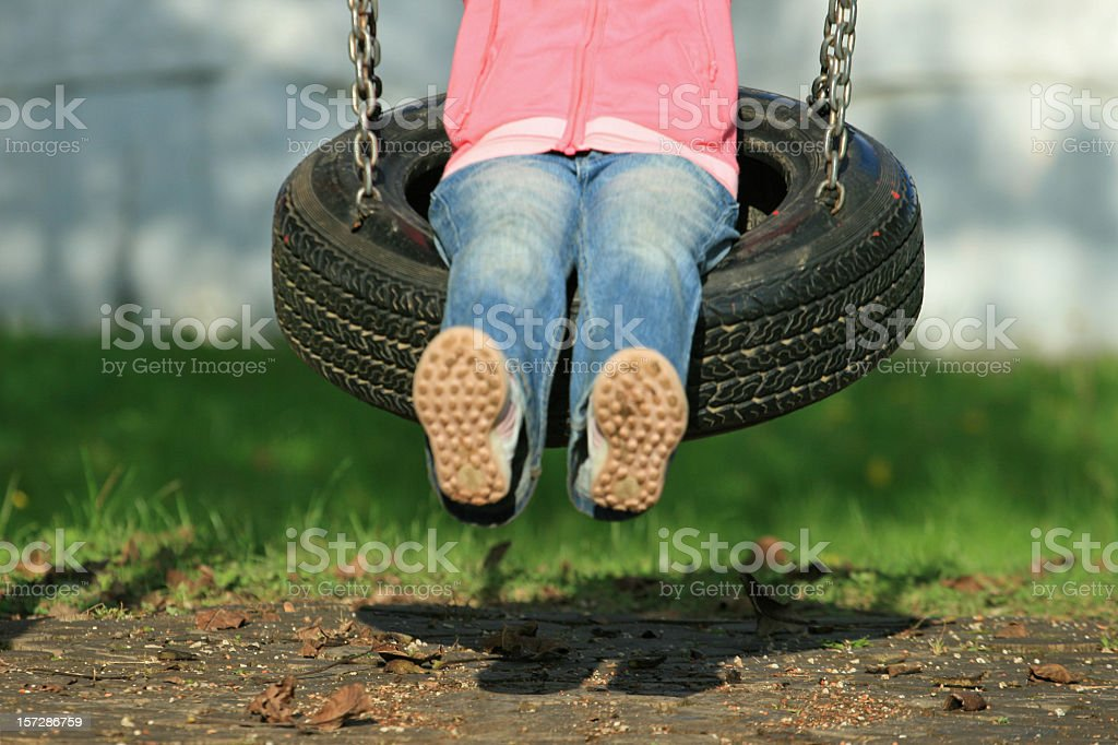 Child on the swing royalty-free stock photo
