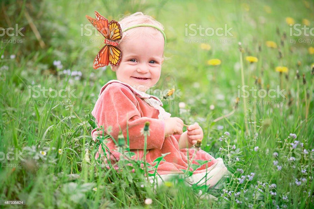 Child on the wild flowers field stock photo