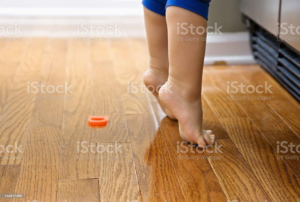Child on tiptoe. stock photo