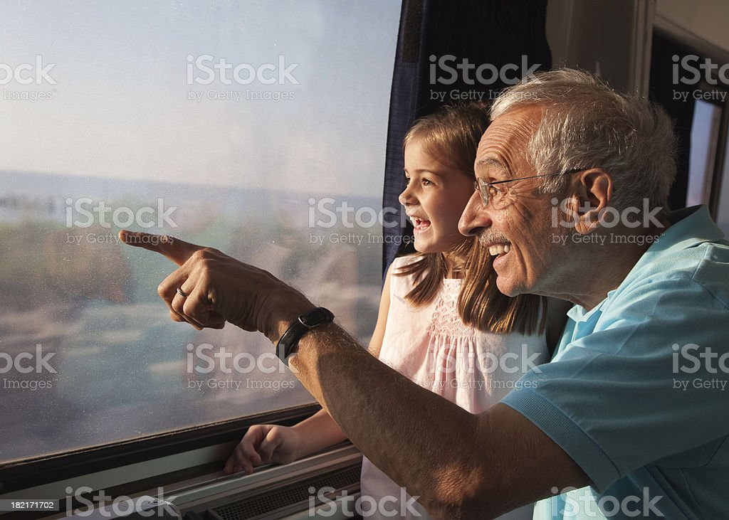 Child on Train Ride with Grandpa stock photo