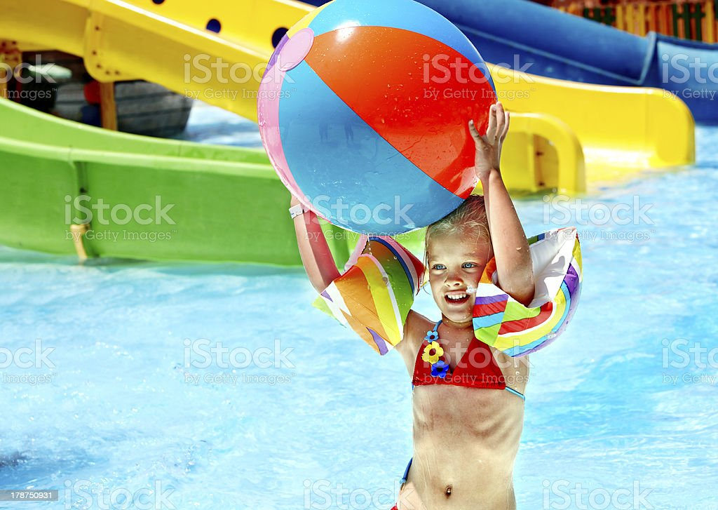 Child on water slide at aquapark. royalty-free stock photo