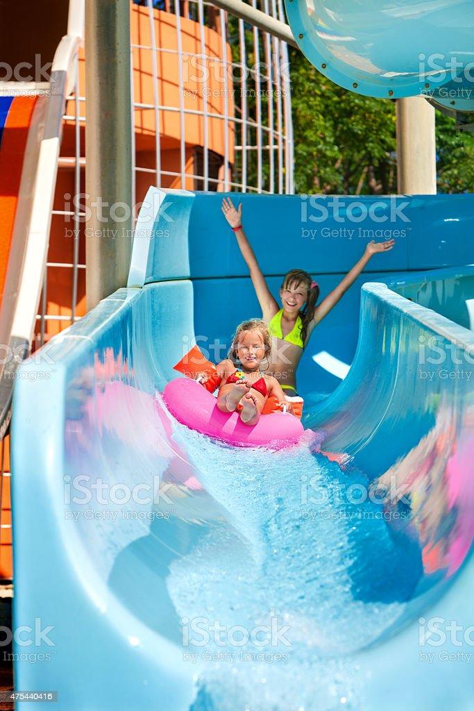 Child on water slide at aquapark stock photo
