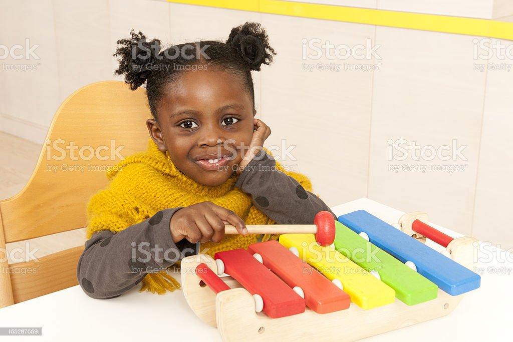 Child on Xylophone royalty-free stock photo