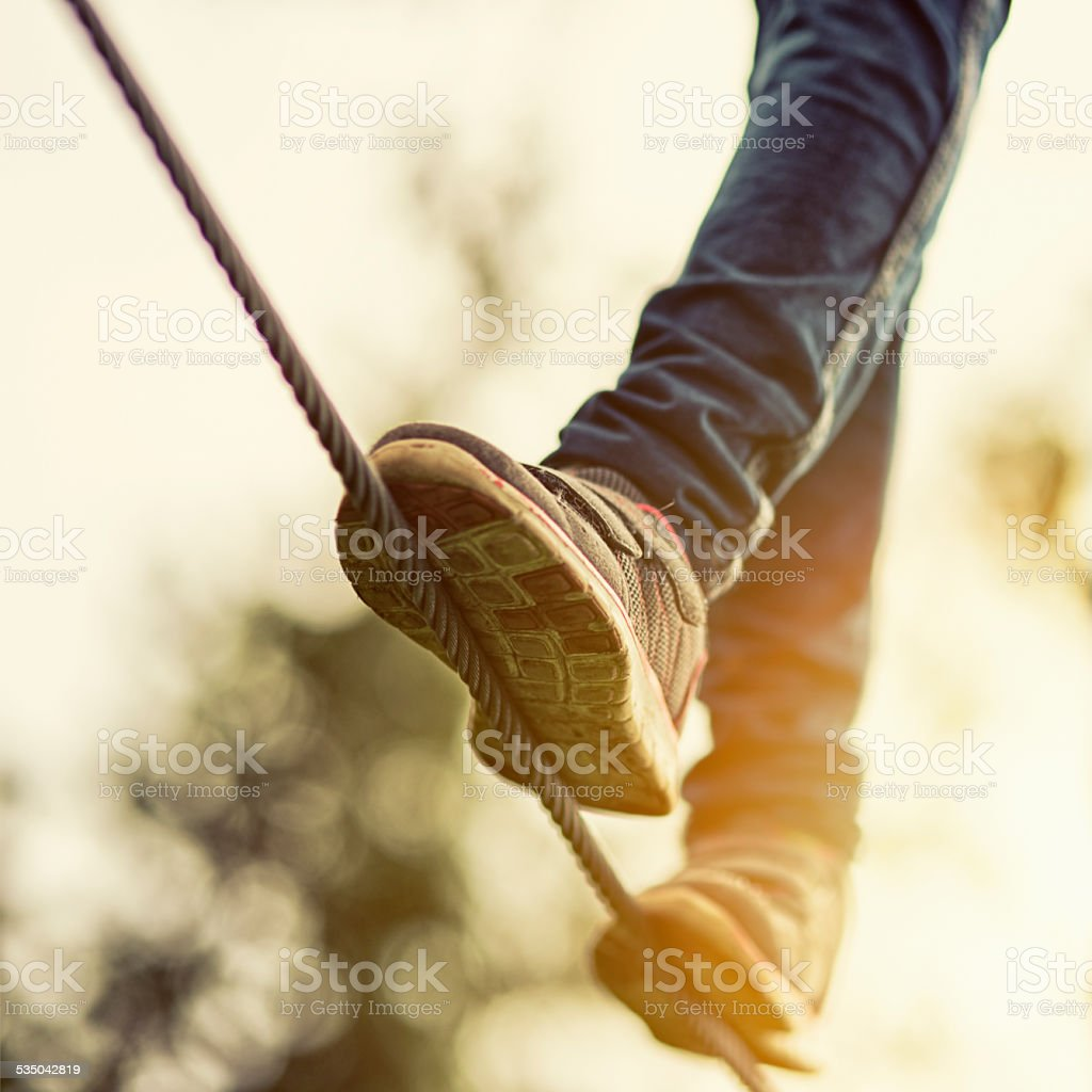 Child on zip line in adventure park stock photo