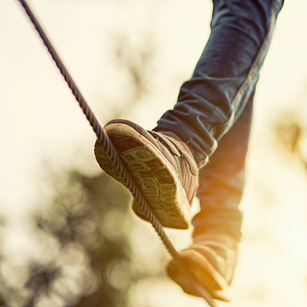 child on zip line in adventure park - courage stock photos and pictures