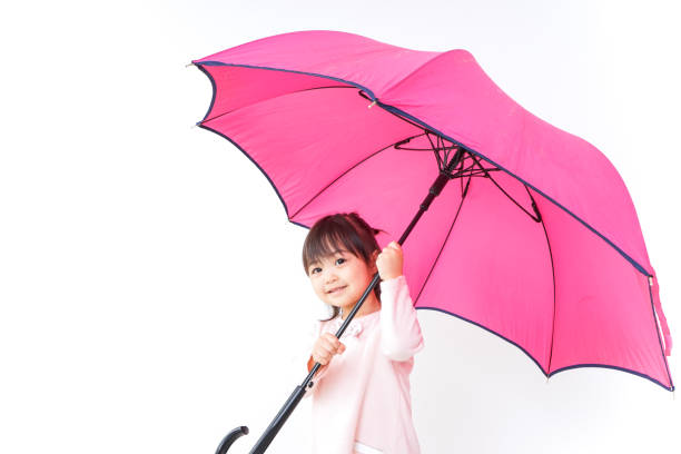 a child opening an umbrella - mockup outdoor rain foto e immagini stock