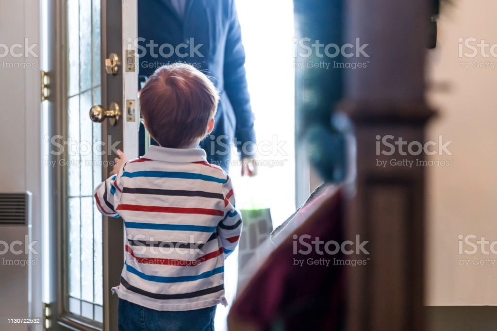 Child Opening Door to Father after day of work or Delivery Person