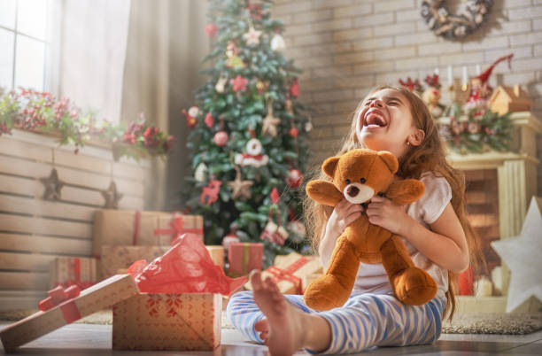 child opening present stock photo - Free Christmas Toys