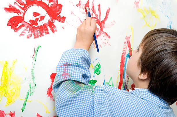 enfant peinture - gaucher photos et images de collection
