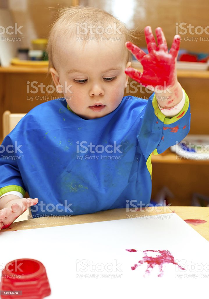 Child painting with hand royalty-free stock photo
