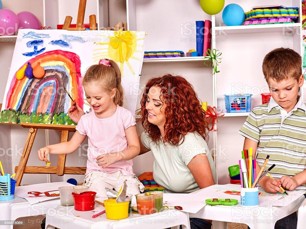 Child painting with mum stock photo