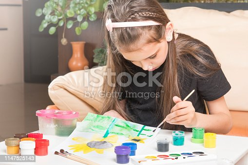 Child paints.