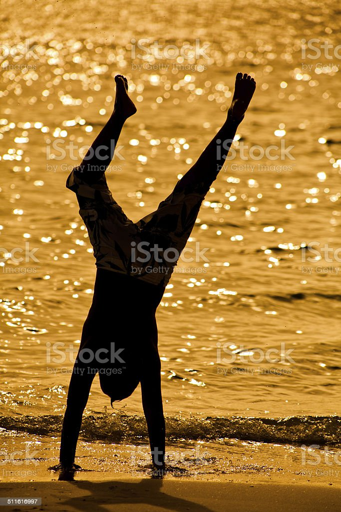 child performing a hand stand. stock photo
