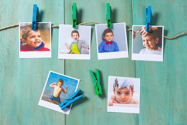 Child photographs hanging on a clothesline stock photo