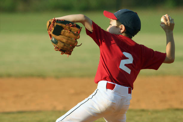 Child pitching for a baseball game stock photo
