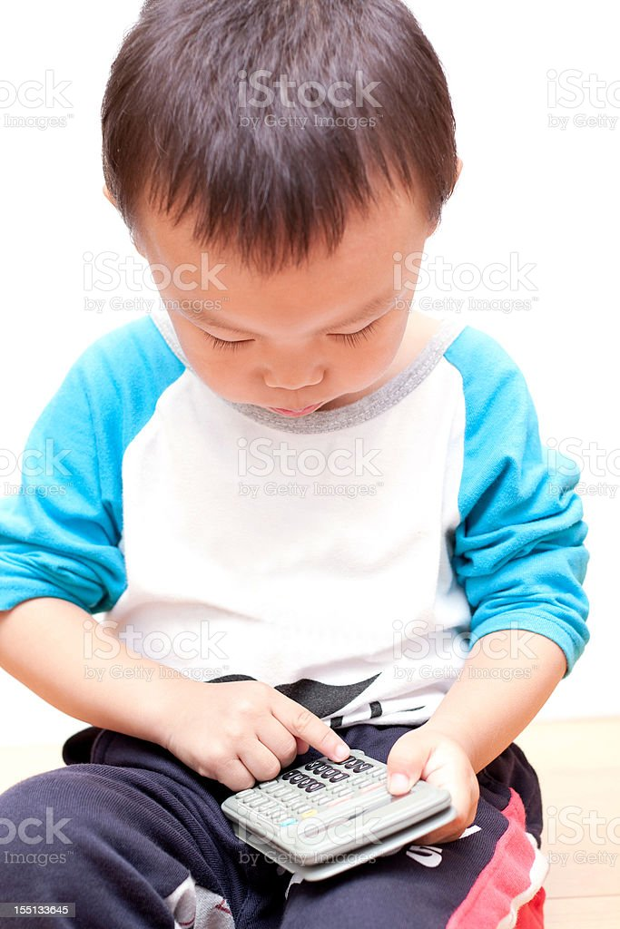 Child playing Calculator royalty-free stock photo