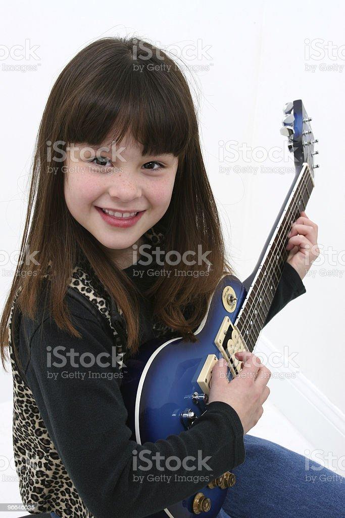 Child (girl) Playing Electric Gutiar. royalty-free stock photo