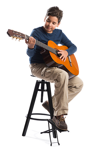 child playing guitar on chair stock photo download image now istock. Black Bedroom Furniture Sets. Home Design Ideas