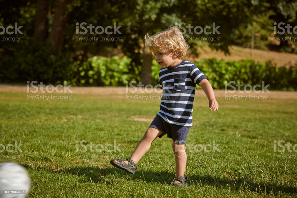 child playing in park stock photo