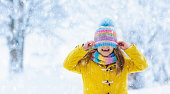 istock Child playing in snow on Christmas. Kids in winter 1207067344
