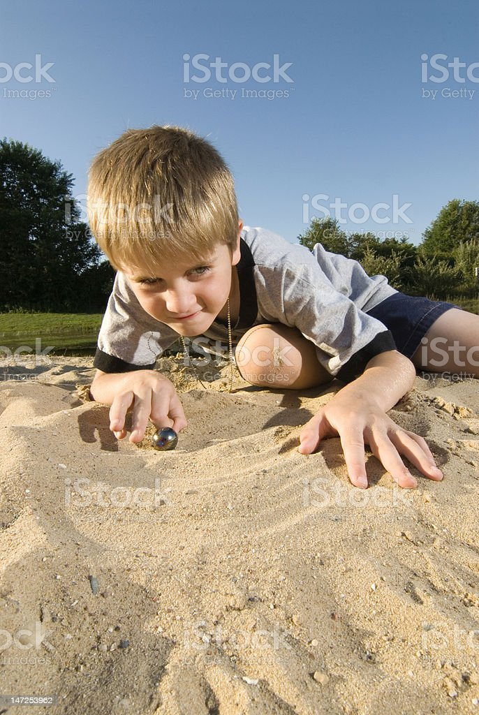 Child playing marbles royalty-free stock photo