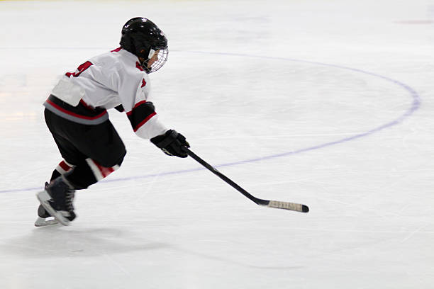 Child playing minor hockey stock photo