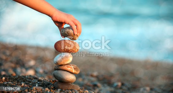 istock child playing on beach 157694738