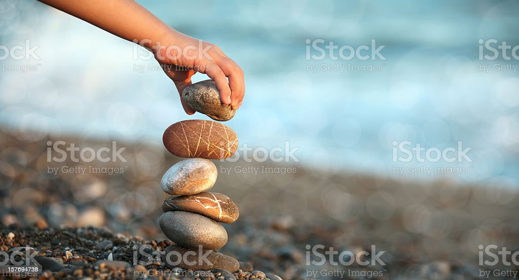 child playing on beach stock photo