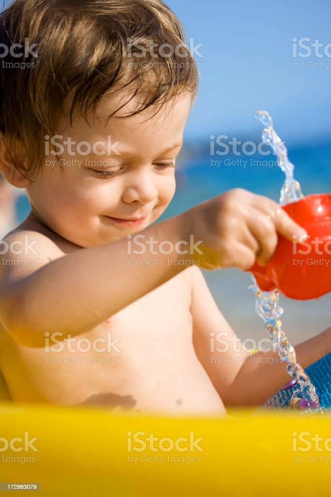 Child playing on the beach stock photo