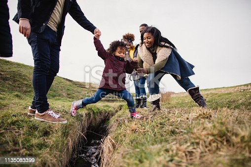 istock Child Playing Outdoors 1135083399