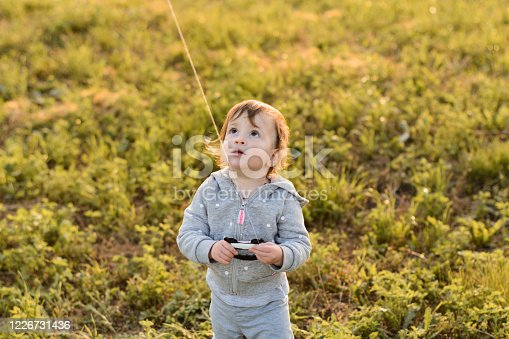 Little girl playing whit kite outdoors