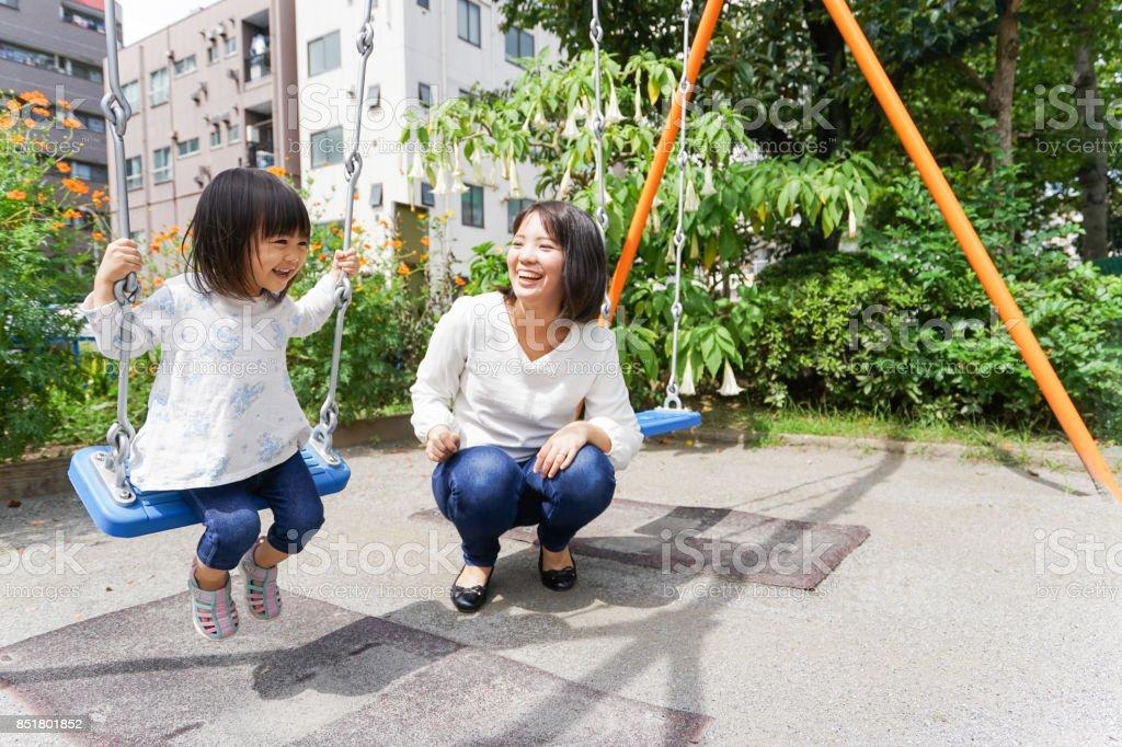 Child playing outside stock photo