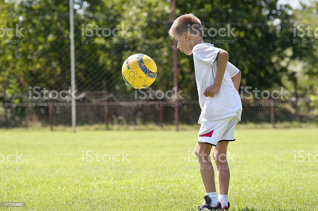 Child playing soccer ball royalty-free stock photo