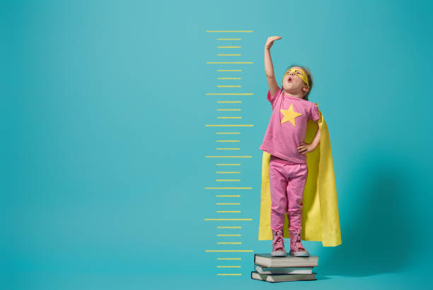 child playing superhero - measuring stock photos and pictures