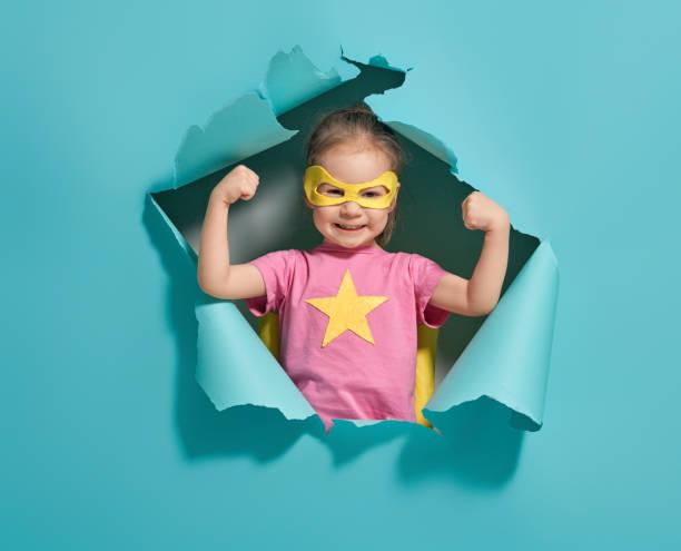 child playing superhero - baby super hero imagens e fotografias de stock