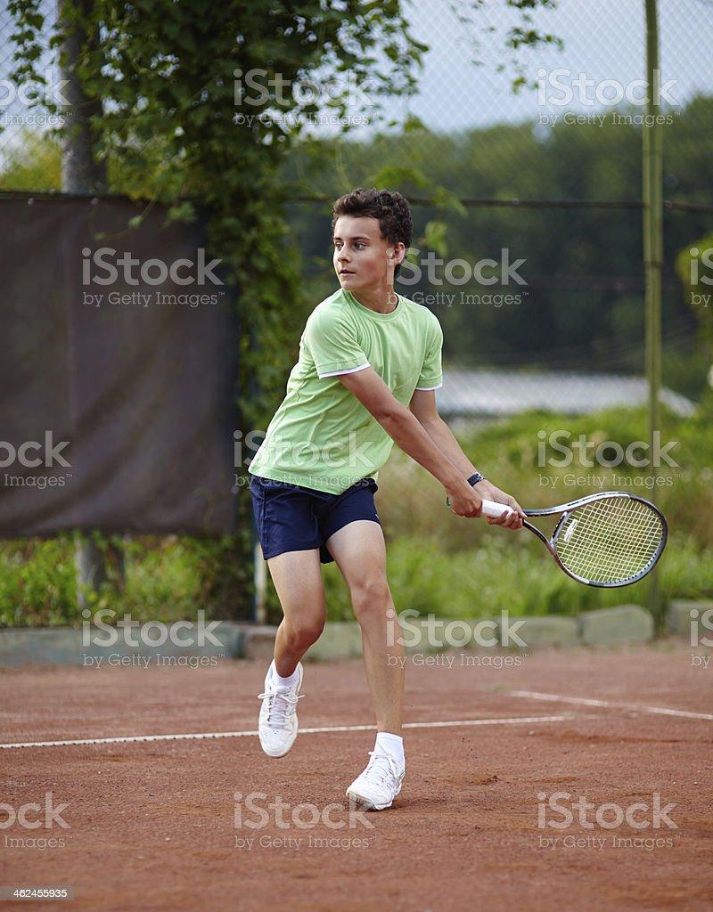 Child playing tennis royalty-free stock photo