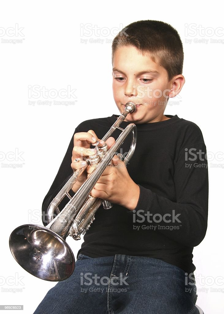 Child Playing Trumpet Instrument stock photo
