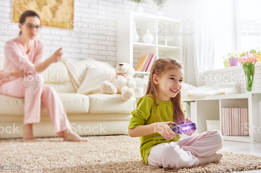 child playing video games stock photo