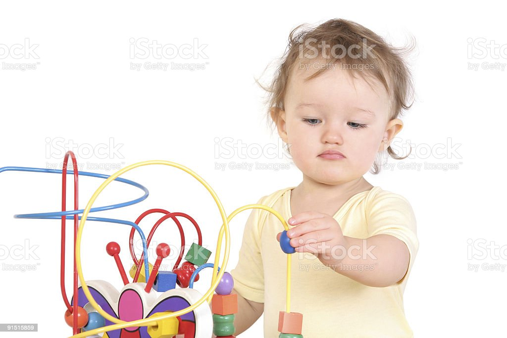 child  playing with a developing toy stock photo